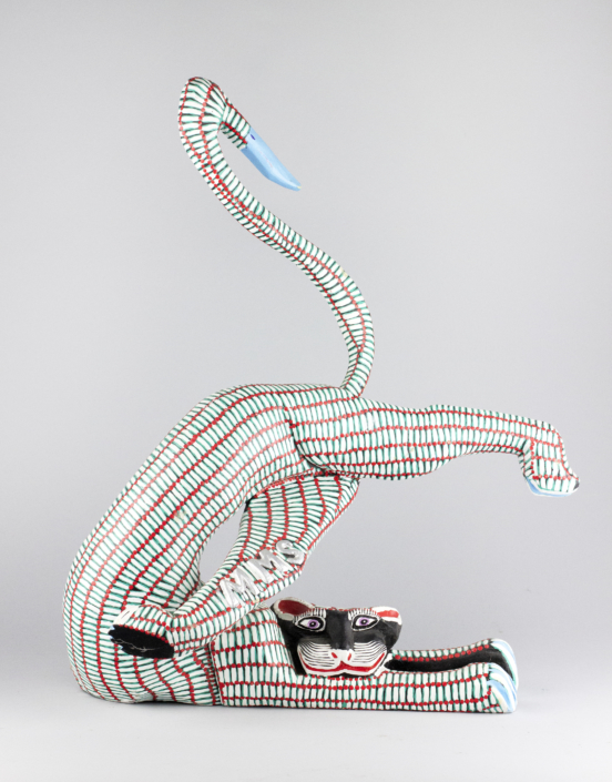 Margarito Melchor and Maria Teresa Santiago, Red and White Striped Cat, 1989 wood, 9 x 14.5 x 22 in Collection of the Tucson Museum of Art. Gift of Shepard Barbash and Vicki Ragan. 2018.22.330